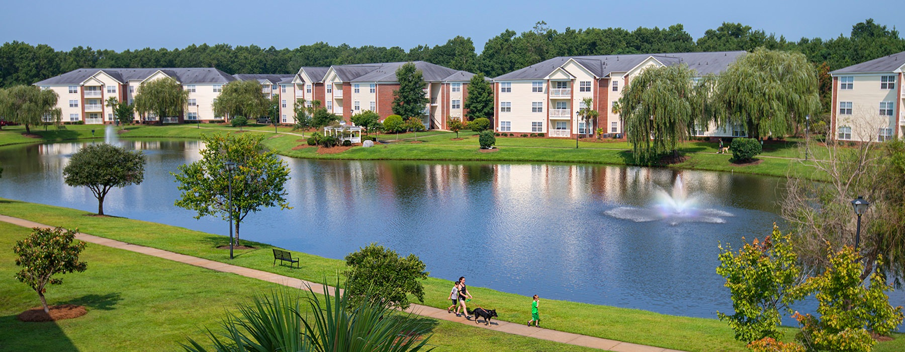 Overview of Seaside Grove apartments overlooking a pond